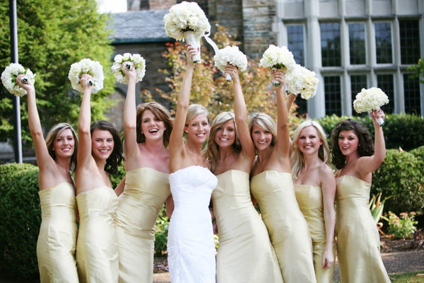 Strapless Bridesmaid gowns in affondil with uniform bouquets in hands